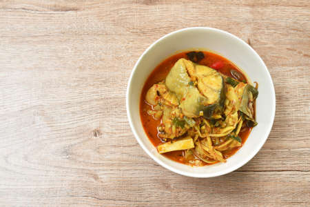 spicy boiled bamboo shoot with slice catfish in coconut milk and curry on bowl Imagens