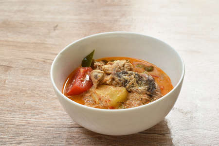 boiled duck with herb in coconut milk curry Thai spicy soup on bowl