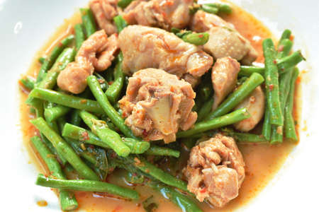 stir fried slice yarg long bean with chicken curry sauce on plate