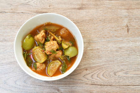 spicy boiled feather back fish ball with vegetable curry soup on bowl