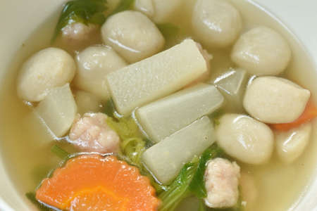 boiled radish with fish ball and mashed pork soup on bowl