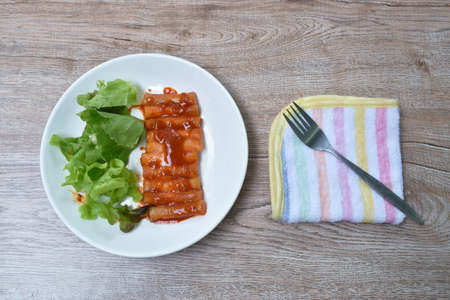 Tteobokki or rice cake Korean food made from flour dressing cheese and red spicy sauce eat couple fresh vegetable on plate