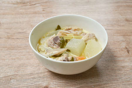 spicy boiled winter melon with chicken bone tom yum soup in bowl