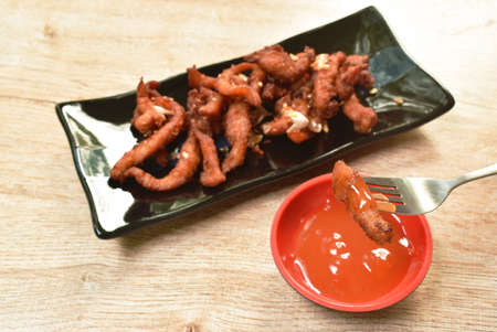 fried fermenting pork with crispy garlic on plate dipping chili sauce