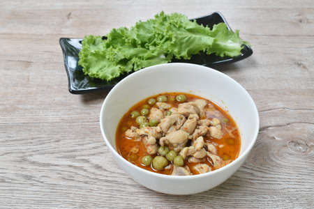 spicy boiled chicken with eggplant in coconut milk curry soup on bowl Imagens