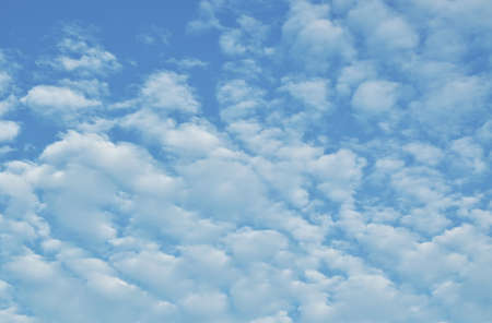 clouds spreading on bright sky in sunny day