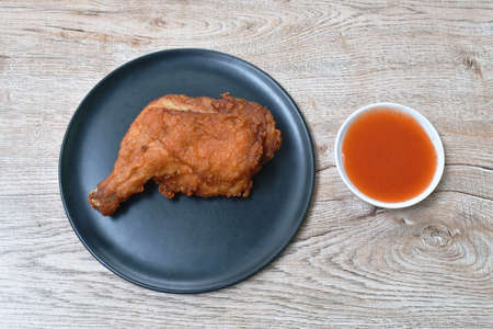 crispy fried chicken tight and leg on plate dipping chili sauce cup Imagens