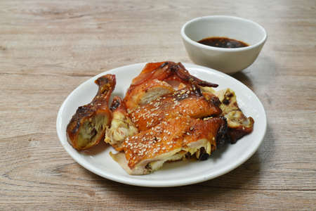 grilled chicken with sauce and sesame on plate dipping spicy sauce