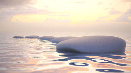 Zen stones in water by the sunset. Stock Photo