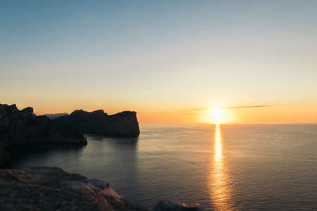sunset in a coast with mountains and cliffs. cap de formentor mallorca