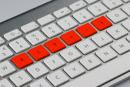 repair  written with red keys in a computer keyboard photo