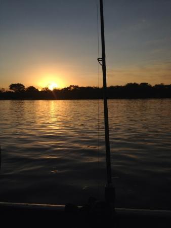 sportfishing: Sunset at Araguaia River while sportfishing.