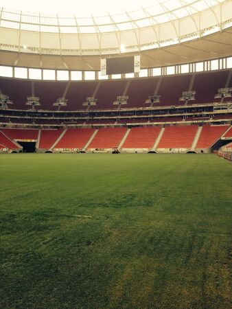 lia: View from the sidelines of Brasilias National Stadium. Stage to the 2013 conferations cup opening march and 7 games of the 2014 World Cup. Stock Photo