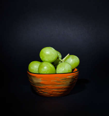 Grapes on a plate on the table