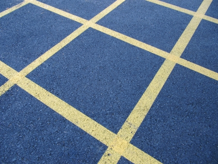 paint box: Box junction, grid intersection road markings. Stock Photo