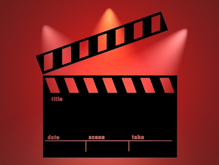 filming: Clapperboard and red lights background Stock Photo