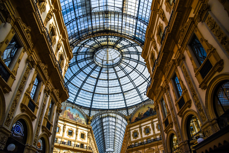 Milan, Italy - May 25 2018: Historical interior architecture of the Gallery Vittorio Emanuele II on Piazza del Duomo (Cathedral Square) in Milan. Traveling and shopping in the one of the world's oldest shopping malls.