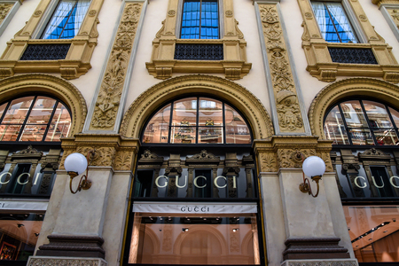 Milan, Italy - May 25 2018: Boutique Gucci whit Galleria Vittorio Emanuele II on background in Milan, Italy Editorial