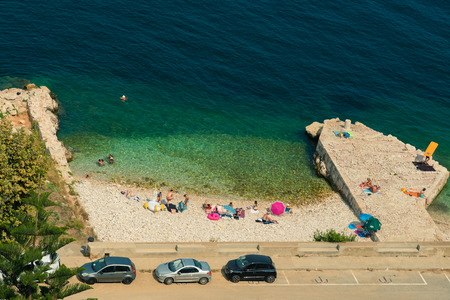 Villefranche sur Mer, France - August 05 2018 : A small beach in Villefranche sur Mer, France
