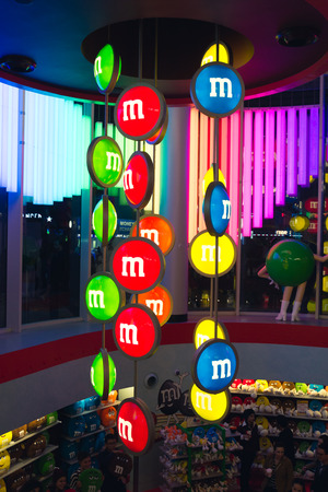 London, England - August 28 2014: Sign of M&Ms store in London. M&Ms World London. The store measures 35,000 square feet and is spread over 4 floors.