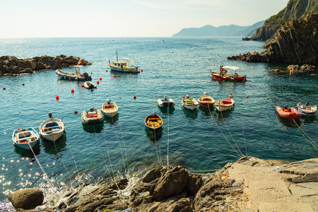 Riomaggiore, Italy - August 06 2018: Boats in the small fishing port of Riomaggiore, Italy. Editorial