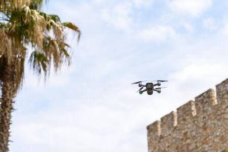 a drone flying and recording