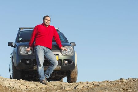Men with his 4x4 car Stock Photo