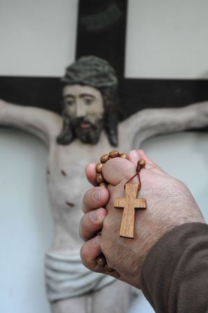 Hands with a crucifix  Stock Photo