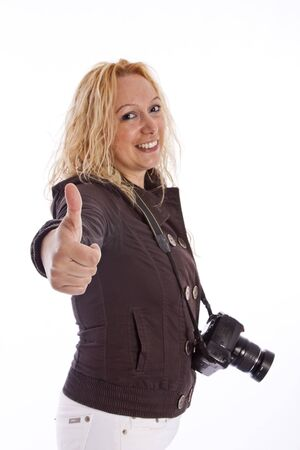 Woman doing ok with hand with camera Stock Photo