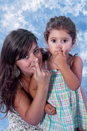 mother and daughter touching nose on stuido session Stock Photo - 7585968