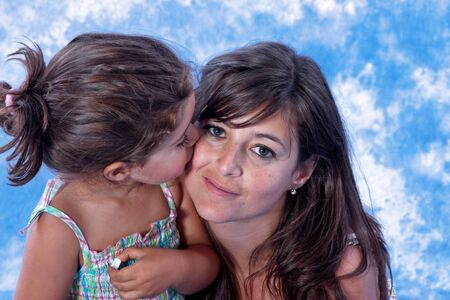 mother and daughter play on studio