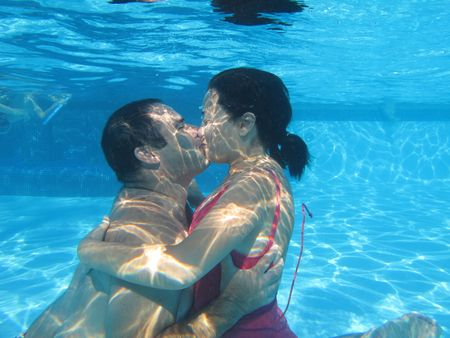 Lovely couple underwater on a swimming pool, underwater photo photo