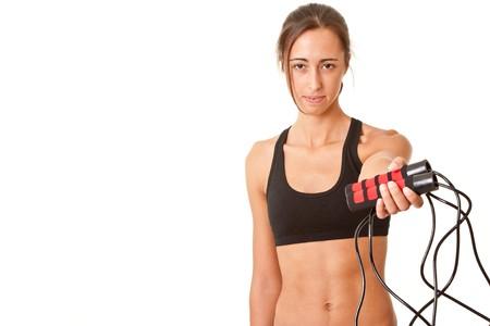 jump rope: Deportes mujer procupada saltar la cuerda