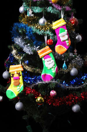toygift: Christmas Tree and Gifts isolated on black background