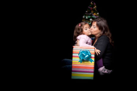 mother and daughter in christmas time photo