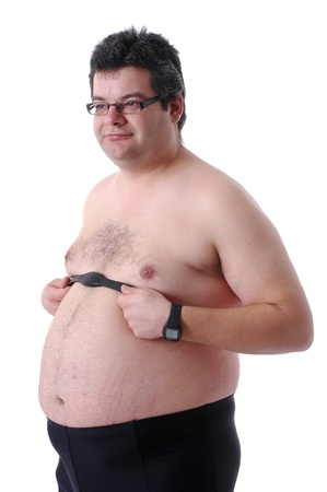 Fat man preparing to workout, adjusting heart rate monitor photo