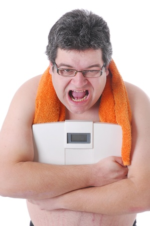 Fat man preparing to workout, mad with scale Stock Photo
