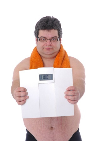 Fat man preparing to workout, with scale happy with results photo