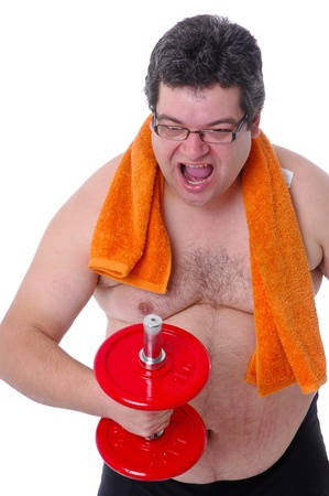 Fat man doing workout with dumbells, angry Stock Photo
