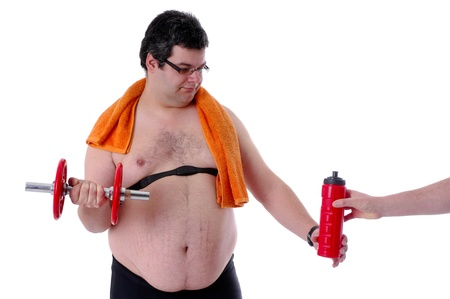 Fat man doing workout with dumbells, receiving water photo