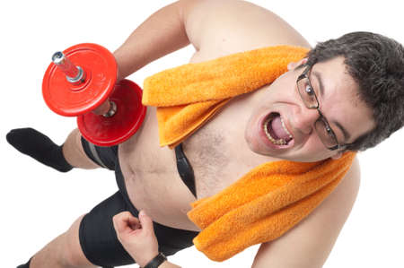 Fat man doing workout with dumbells, mad look