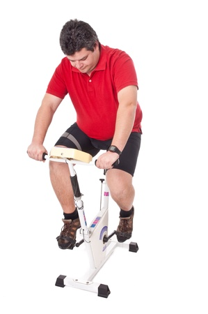 Fat man doing workout in static bicycle Stock Photo