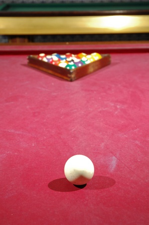a billiard game table with balls and cue photo