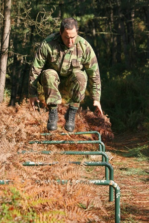 Military physical training, over an obstacle course Stock Photo
