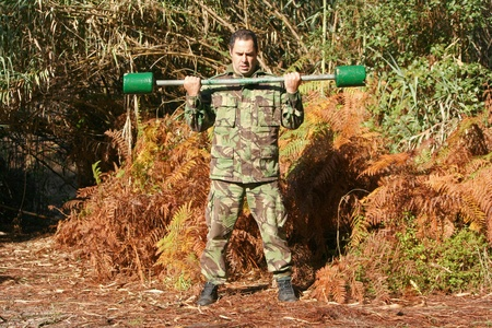 Military physical training, with weights Stock Photo