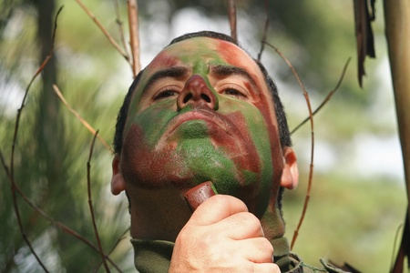 work force: Military training combat, face camouflage  Stock Photo