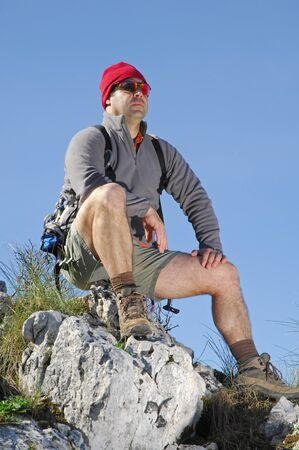 man hiking in a mountain with blue sky Stock Photo - 9813594