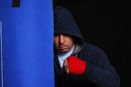 Fighter in concentration moment with a punching bag