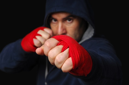Fighter in training moment (focus on the first hand)
