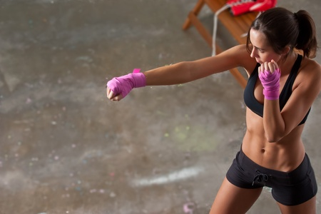boxing sport: Girl training body combat Stock Photo